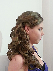 Long cut and style, side tied hair, young woman in profile.
